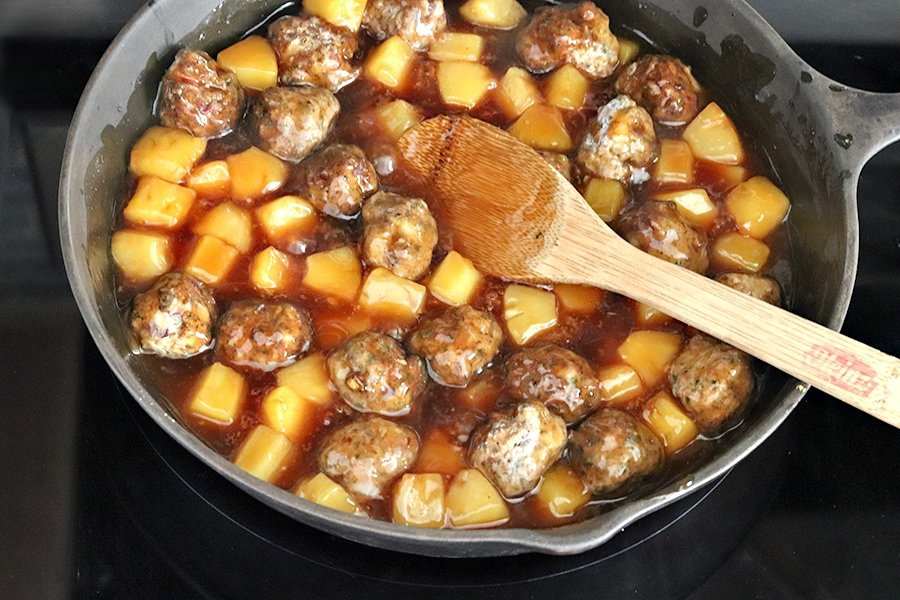 meatballs and pineapple in skillet