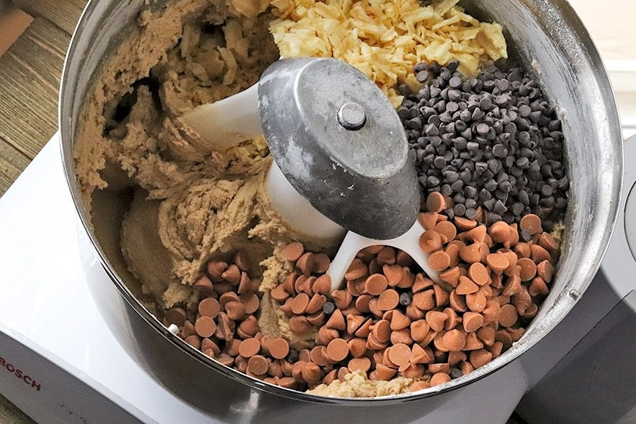 adding chips to potato chip cookie dough