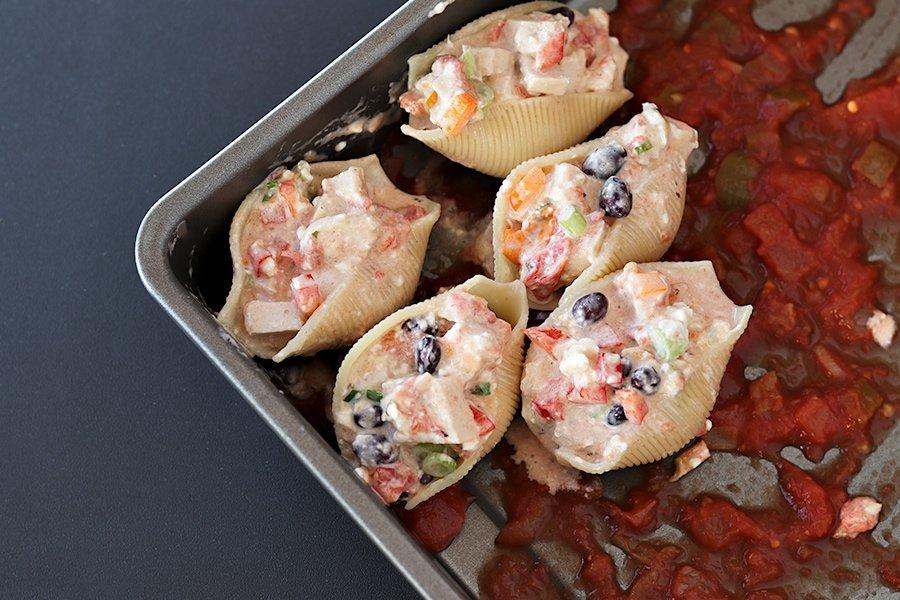 filled shells in baking pan