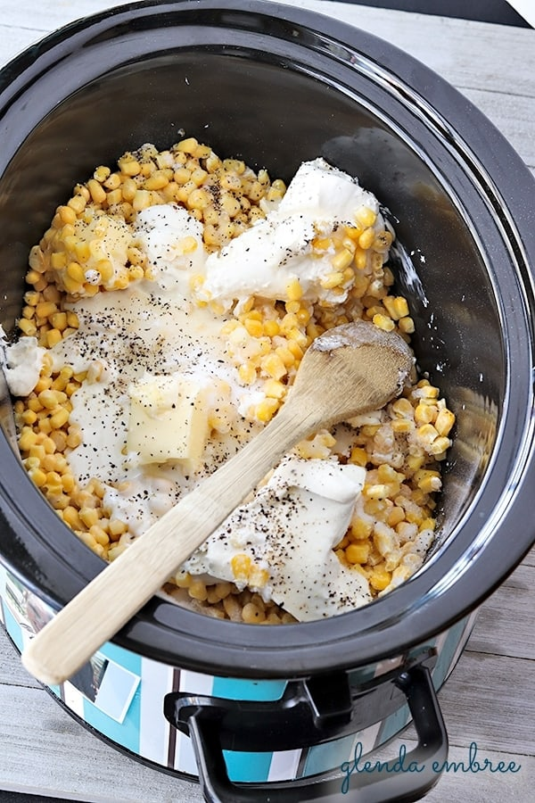 Crock-Pot with ingredients for creamed corn