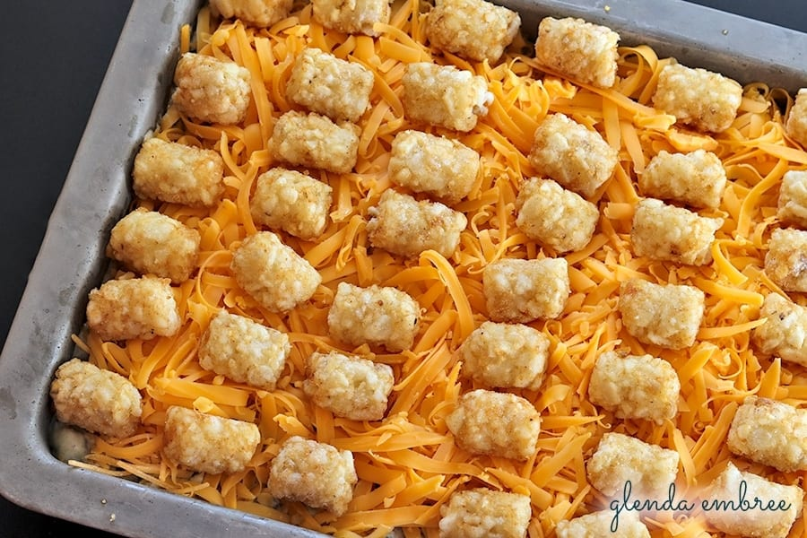 Tater Tot Casserole Supreme ready for the oven - green beans corn