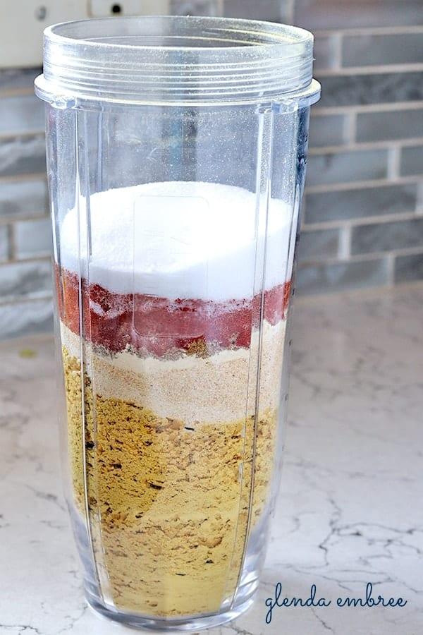 nutritional yeast, garlic powder, onion powder, cumin, paprika, chili powder and salt in a blender jar