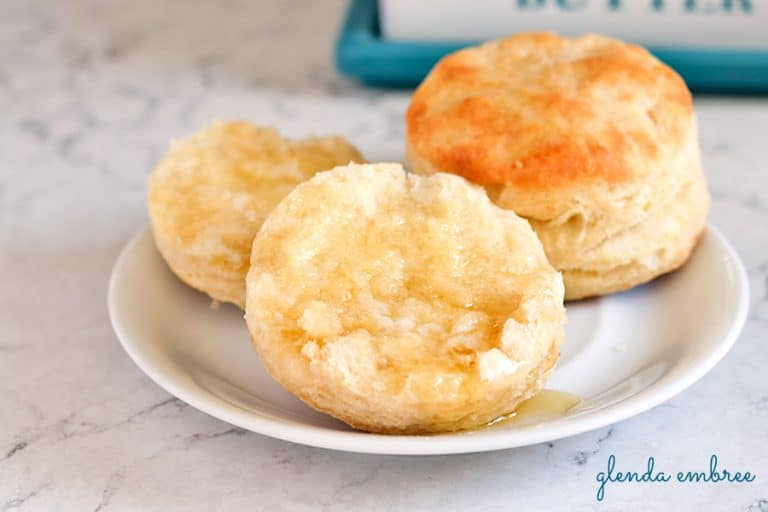 biscuits on a plate with butter and honey