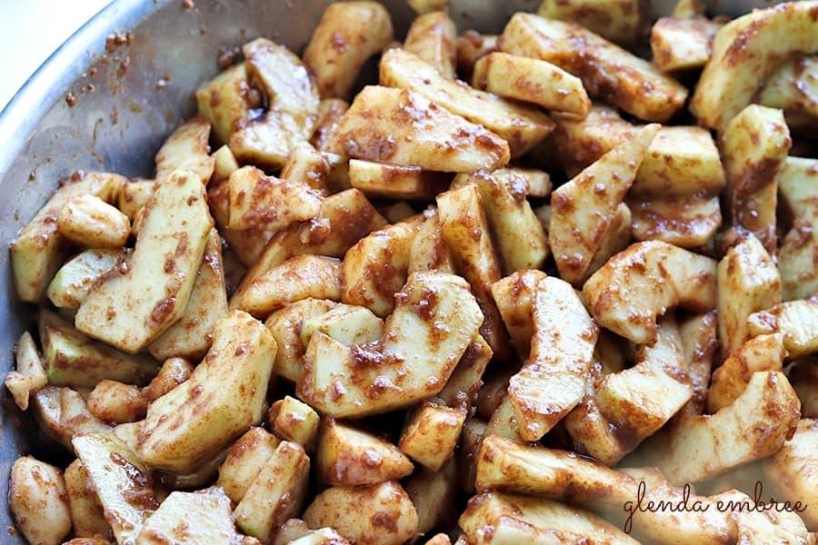 apple slices tossed in flour, sugars, cinnamon and nutmeg