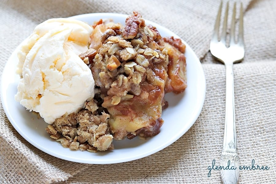 apple crisp made with juicy fall apples and served with ice cream for dessert