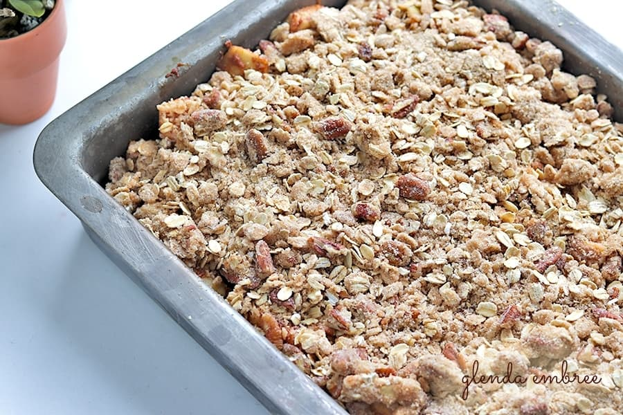 streusel topping spread over apples
