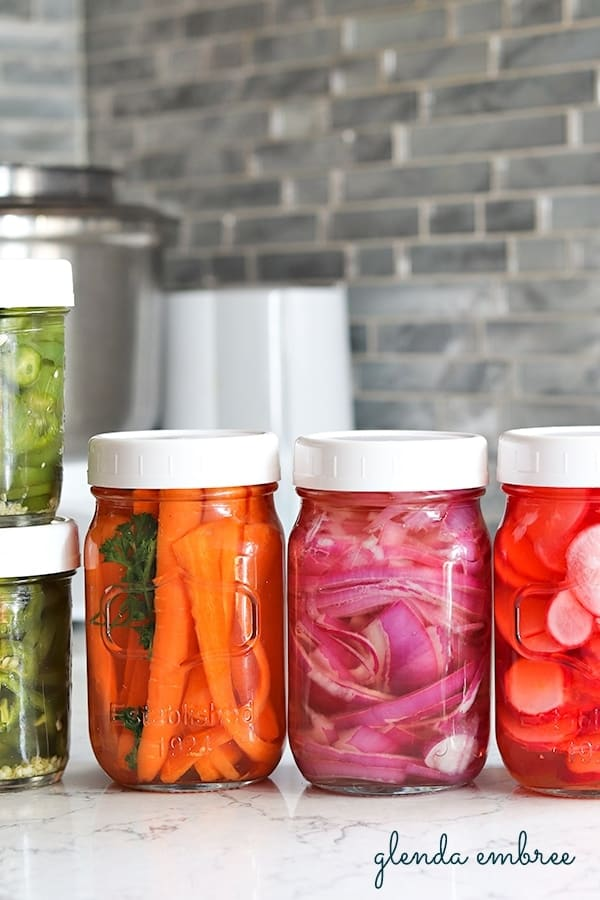 quick pickled jalapenos and quick pickled vegetables in jars
