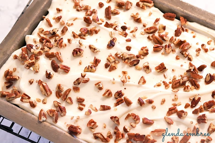 Sour Cream Spice Cake with Cream Cheese Frosting and Chopped Pecans