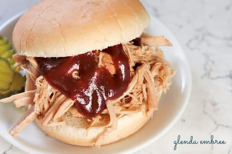 perfect pulled pork sandwich on a white plate