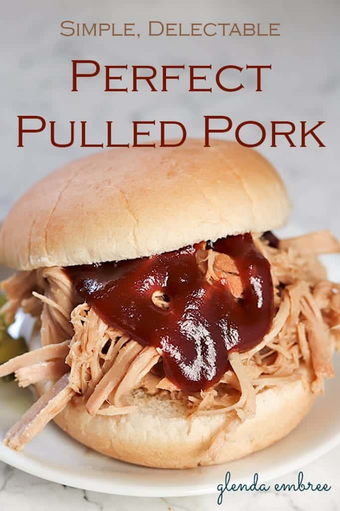 Perfect Pulled Pork Sandwich with barbecue sauce and pickles