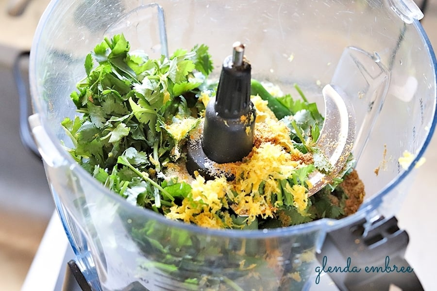 cilantro, lemon zest and lemon juice added to food processor to make homemade yellow curry paste