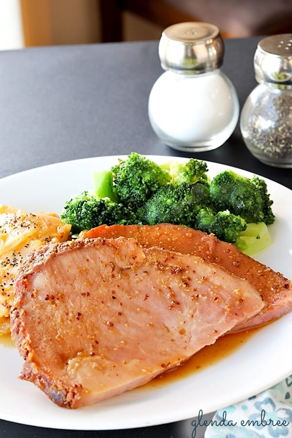 Best Slow Cooker Ham served with cheesy potatoes and broccoli