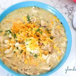 poblano chicken chili with sour cream, shredded cheddar and minced cilantro