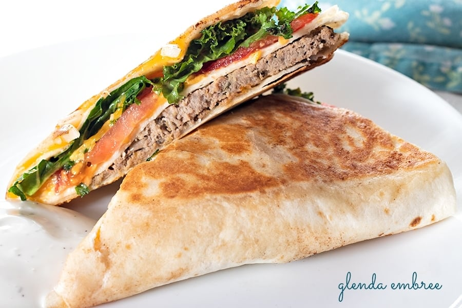 Gyro Quesadilla - with homemade gyro meat, sliced tomatoes, slivered onions, kale and cheddar cheese on a flour tortilla