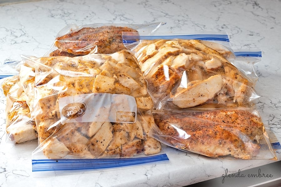 Perfect Baked Chicken Breasts prepped for storage in fridge or freezer.  Bags of sliced, chopped and whole chicken breasts in zip-top freezer bags.