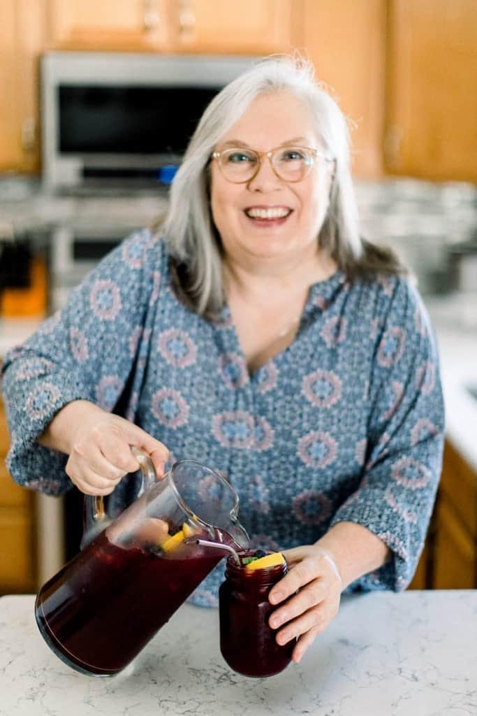 Glenda Embree, from glendaembree.com recipe blog, pouring Blueberry Lemonade.