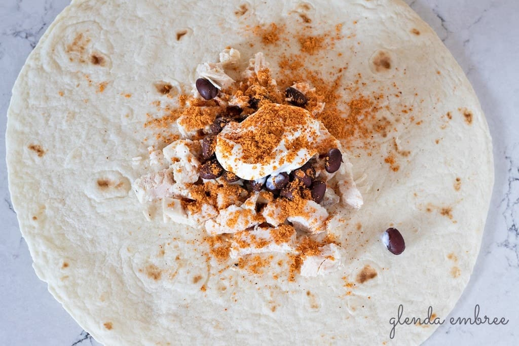 How to Assemble a Crunch Wrap: Add taco seasoning