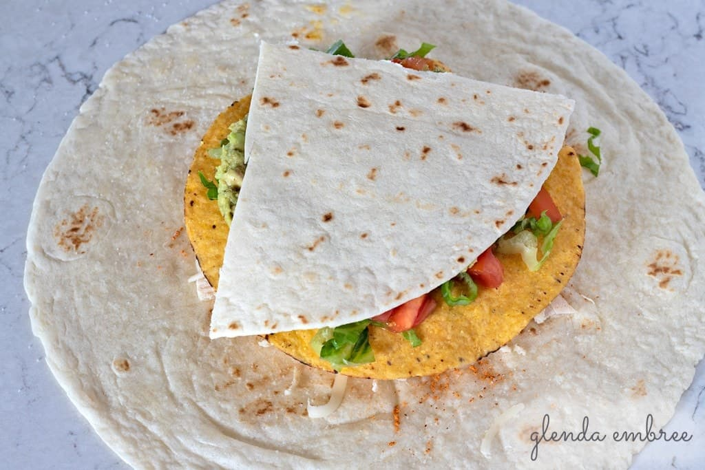 How to Assemble a Crunch Wrap: Add the ¼ wedge of flour tortilla