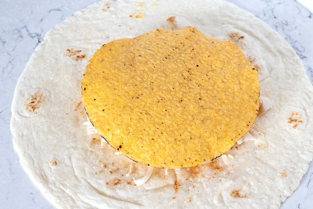 How to Assemble a Crunch Wrap: Add the tostada Shell
