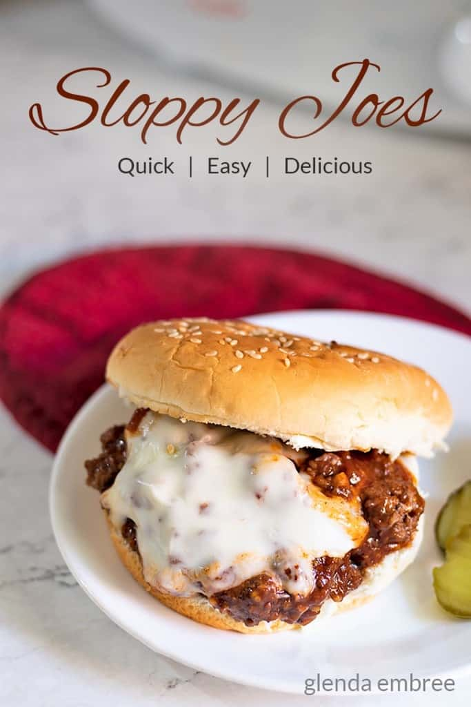 Best Sloppy Joe on a white plate with a red mat underneath.